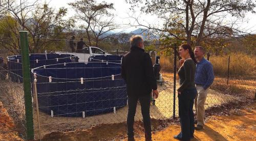 Cobus Raath, owner of the ranch, explaining the research to Dorothy Breed and Leith Meyer